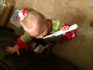 I know it's not Sarabeth with my phone (I couldn't find one on this computer), but Sarabeth has learned brushing her teeth from watching our example as well - she just happens to prefer Eric's toothbrush to her own!